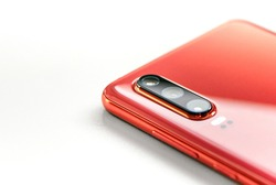A closeup shot of a red phone isolated on white background