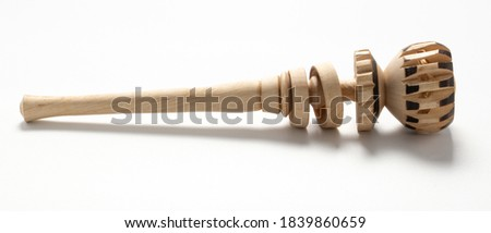 A closeup shot of a wooden chocolate grinder cooking tool isolated on a white background  (molinillo) Foto stock ©