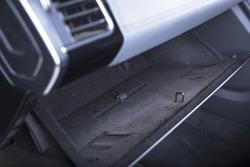 A closeup shot of an open glove compartment in a modern car