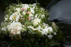 A closeup shot of decorative white bouquets on a car