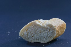 A closeup shot of freshly baked bread ona blue surface