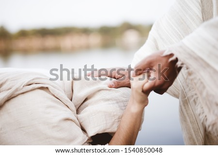 A closeup shot of Jesus Christ healing the female with a blurred background Stock photo ©