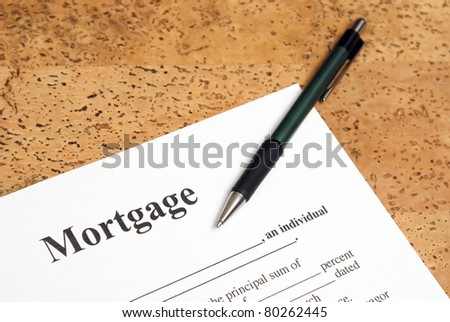 A closeup shot of mortgage forms for the people buying a house.