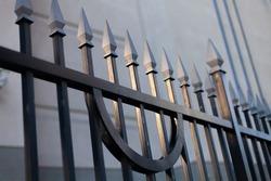 A closeup shot of sharp spikes on a gate