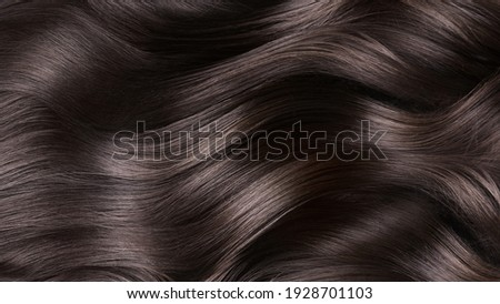 A closeup view of a bunch of shiny curls brown hair. Stock foto ©