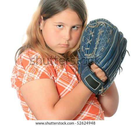 closeup view of a preteen girl wearing casual clothing is playing ...