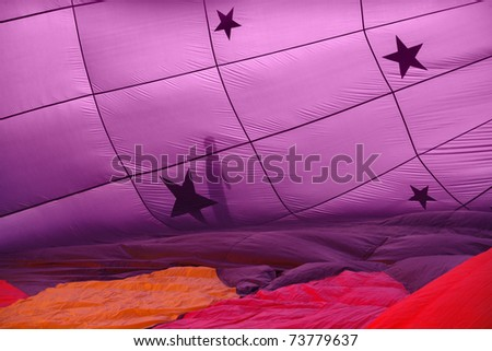 A closeup view of the wall of an inflating hot air balloon