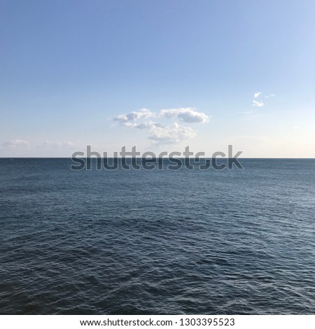 A cloud in the clear sea and clear sky
