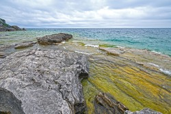 A Cloudy Day on a Wilderness Shore of the Great Lakes on Lake Huron in Bruce Pennisula National Park in Ontario