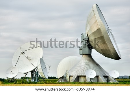 A cluster of satellite dishes at a research station