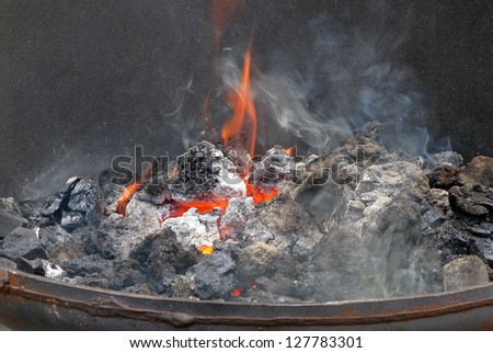 A coal fire, used by blacksmiths for metal working.