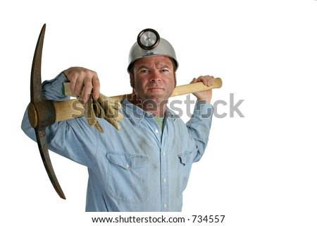 A coal miner with a pickax resting on his shoulders - isolated.