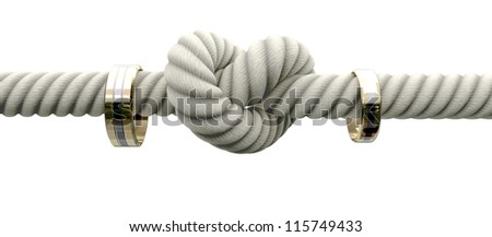 A coarse rope with a knot tied in the middle threaded through two wedding rings attached to either side on an isolated background