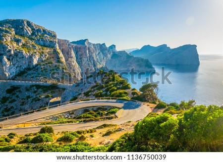 A coastal road winding through Mallorca towards Far formentor lighthouse, Spain