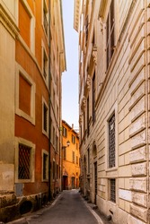 A cobbled old lane in Rome with old dilapided palaces
