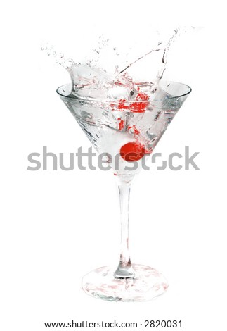 A cocktail drink with an cherry splash