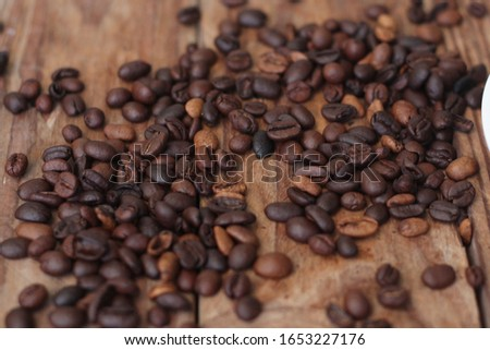 A coffee bean is a seed of the Coffee plant and the source for coffee. The fruits most commonly contain two stones with their flat sides together.