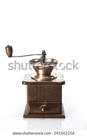 A coffee cup and coffee beans and grinder isolated white at the studio. #245262256