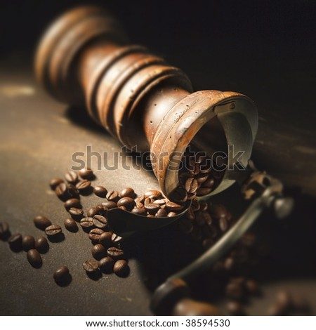A coffee grinder on a table still life