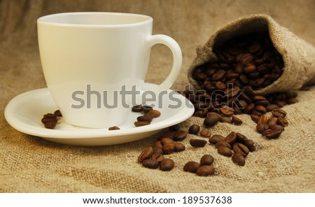 a coffee mug and coffee beans