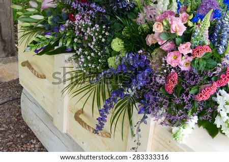 A coffin with a flower arrangement