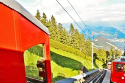 A cogwheel train ride experience from Mount Pilatus to  Alpnachstad, known for being the worlds steepest cogwheel train.