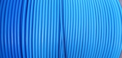 A coil of blue cable. Blue line background. Blue wires.