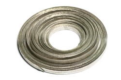 A coil of magnesium ribbon, a chemical element which burns with an incredibly bright white flame, and used in marine flares
