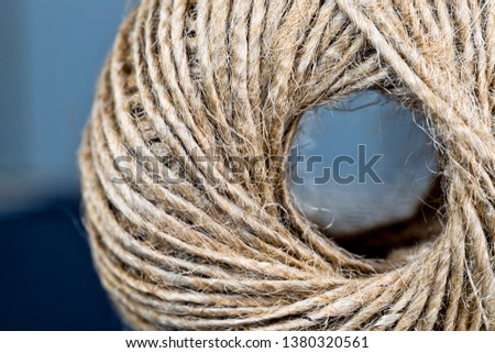 a coil of strong linen and gray rope coiled for convenience, closeup of building materials #1380320561