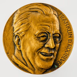 A coin commemorating featuring a portrait of  Franklin Delano Roosevelt. 32nd President of the United States. Commemorative Coin.