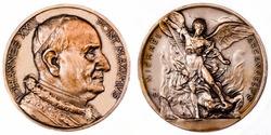 A coin commemorating featuring a portrait of JOHANNES XXIII PONT MAXIMVS