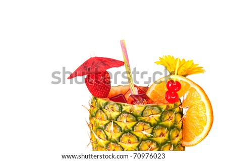 A cold, refreshing tropical rum drink with a pineapple glass, strawberry, cherries and an orange slice isolated on a white background. - stock photo