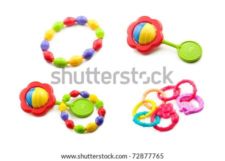 A collage of baby toys including teething rings, and rattles isolated on a white horizontal background