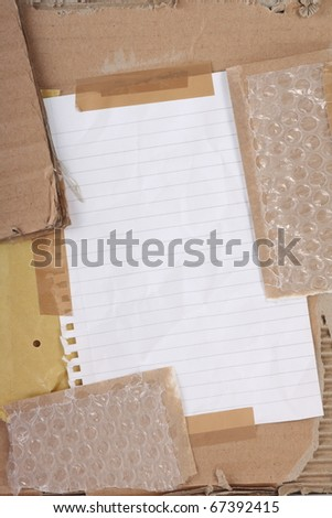 A collage of cardboard,bubble wrap,adhesive tape and paper to form a textured background with copy space
