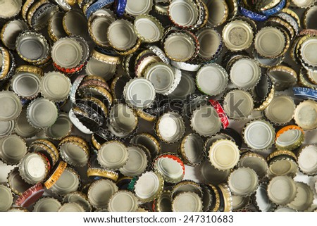 a collection of beer bottle caps representing the craft beer industry