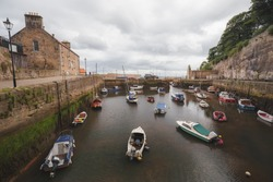 A collection of boats at Dysart Harbour, in the seaside village of Dysart in Fife, Scotland.