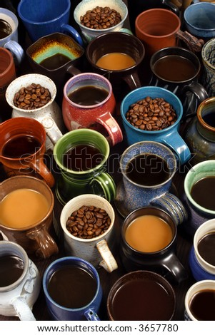A collection of ceramic coffee mugs filled with different coffee - background image for coffee establishments.