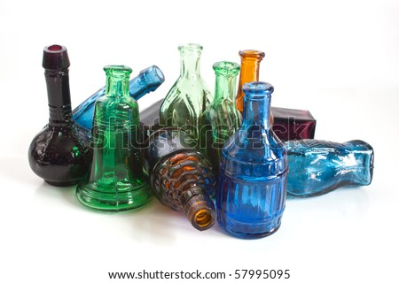 a collection of colourful vintage style medicine bottles