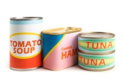 a collection of generic labeled food tins or cans isolated on white
