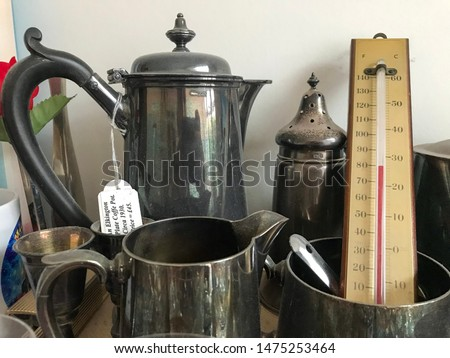 A collection of pewter jugs and tableware with a thermometer. #1475253464