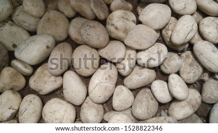 a collection of rounded white stones