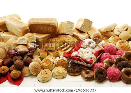 A collection of savory and sweet baked goods on an isolated white background