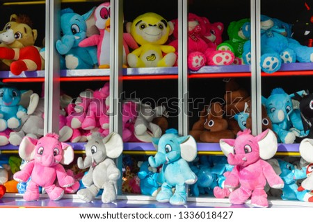A collection of stuffed animals given as prizes at a carnival or fair. #1336018427