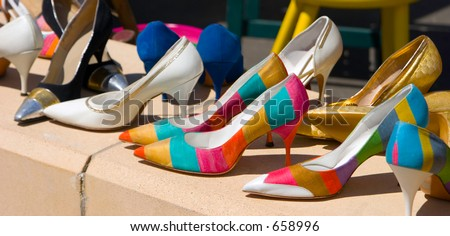 A collection of stylish and colorful high heels looking like the beginning of a fetish.