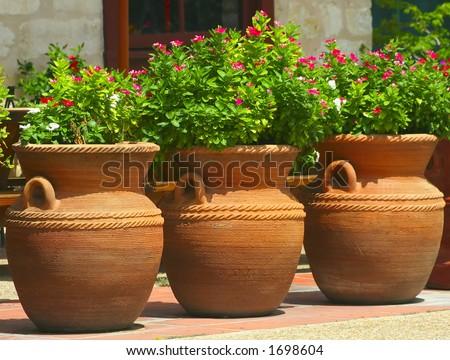 a collection of three clay pots in San Antonio, Texas #1698604
