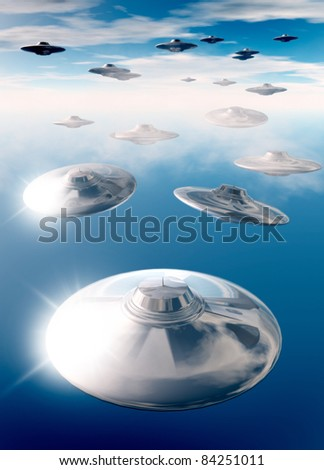 A collection of UFO's are seen flying through the evening sky as seen from below.