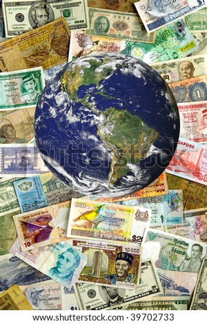 A collection of various currencies from countries spanning the globe.  Earth image courtesy of NASA.