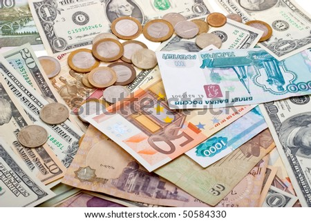 A collection of various money to background. Isolated on white.