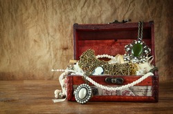 A collection of vintage jewelry in antique wooden box