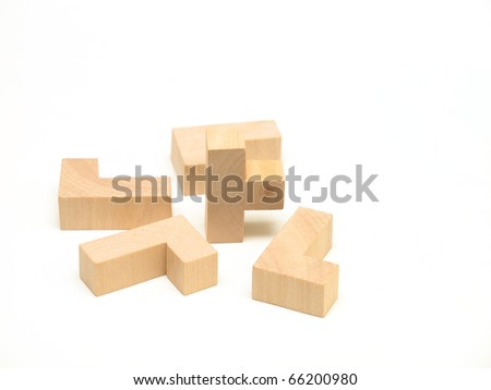 A collection of wooden puzzle elements on white surface.